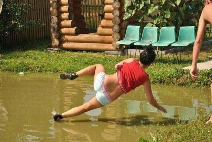 girl slips on mud
