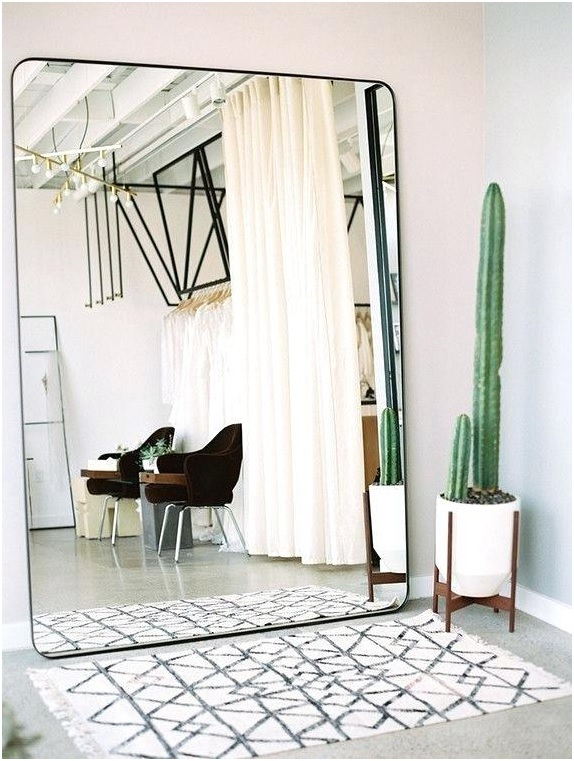 Use mirrors to trick the eye - interior design tricks for small bedroom