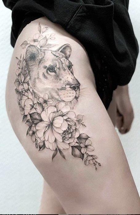 Lion-thigh-tattoos for women
